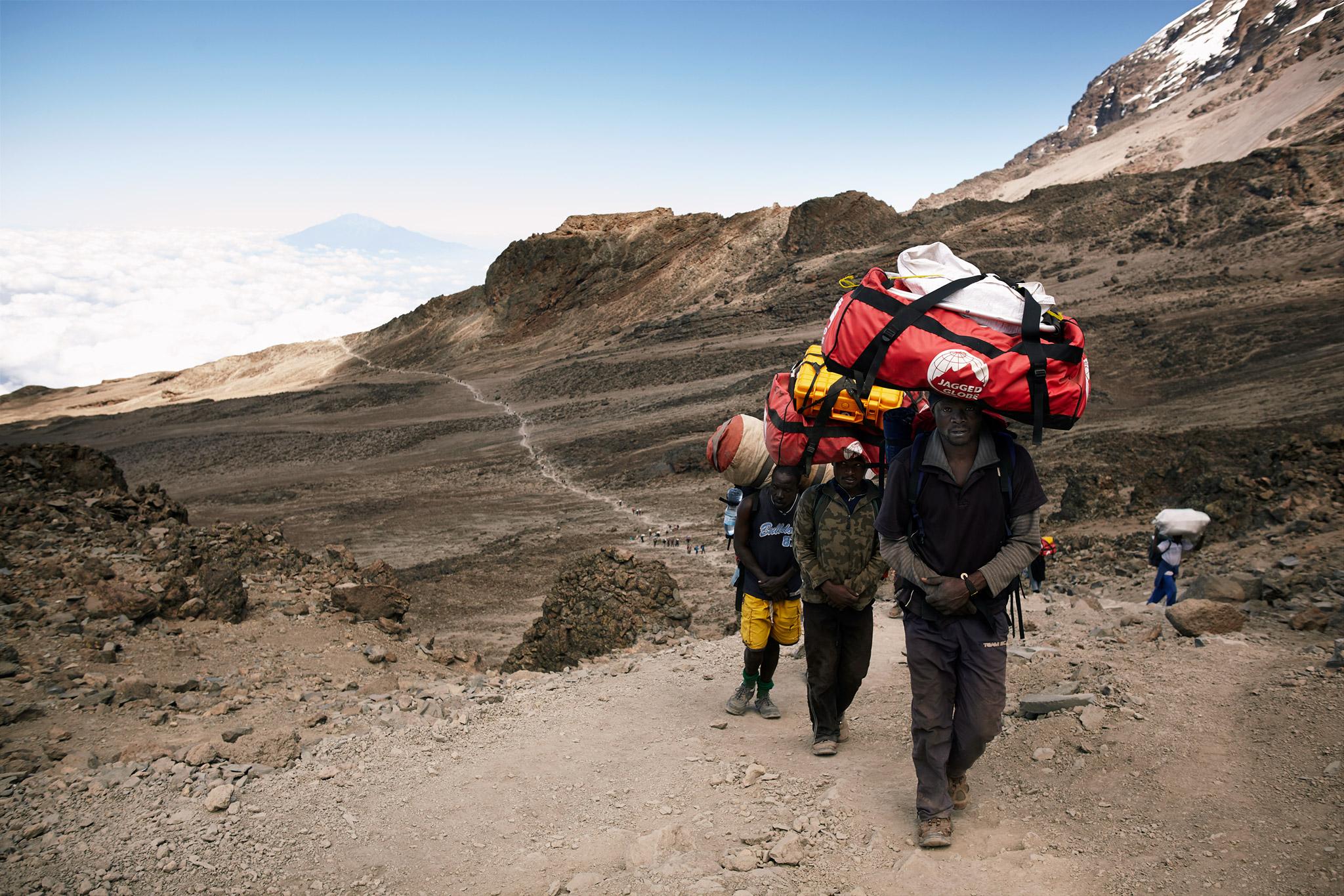 Porters of Kilimanjaro carrying luggage