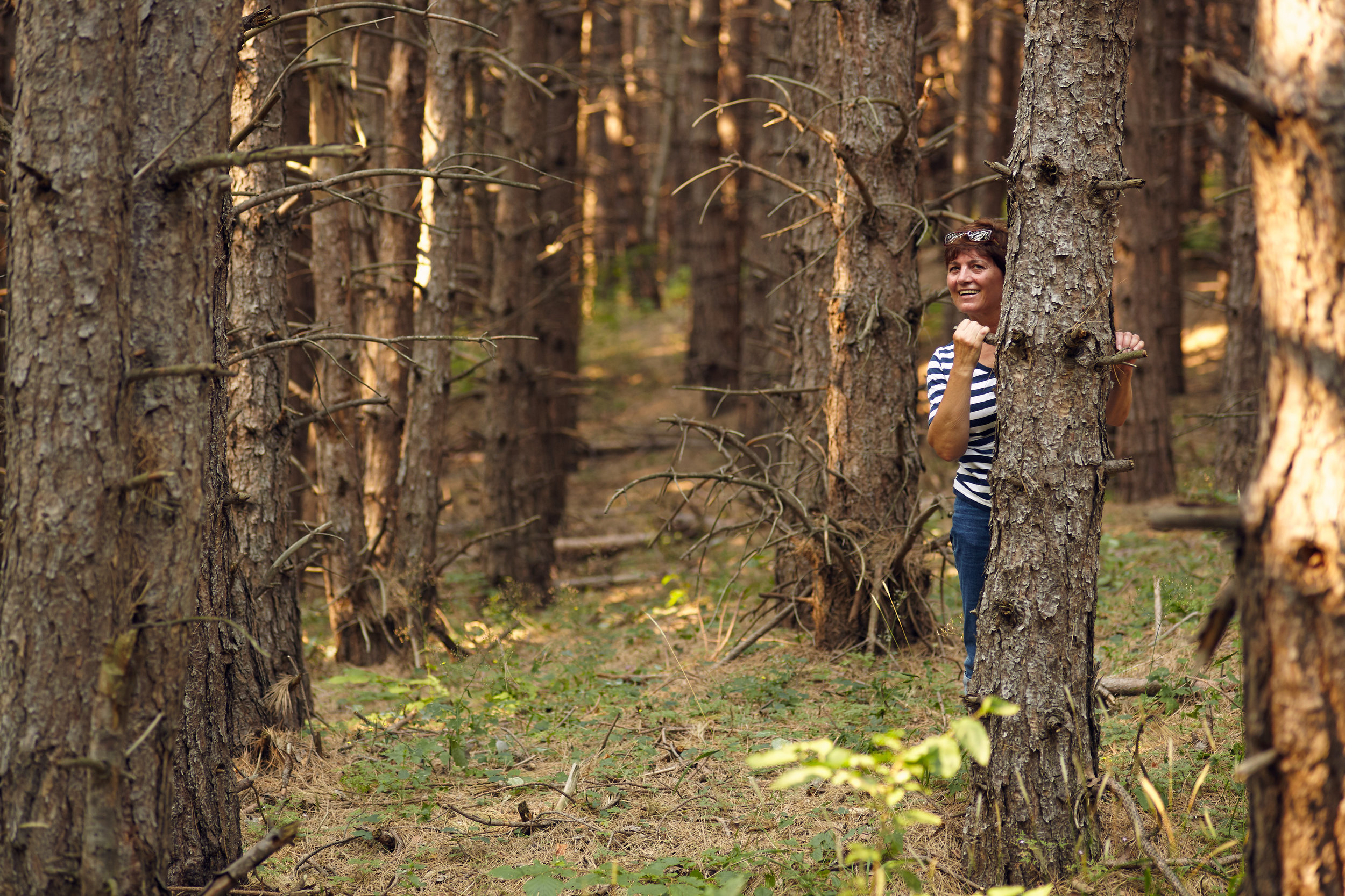 Woman hiding in forest