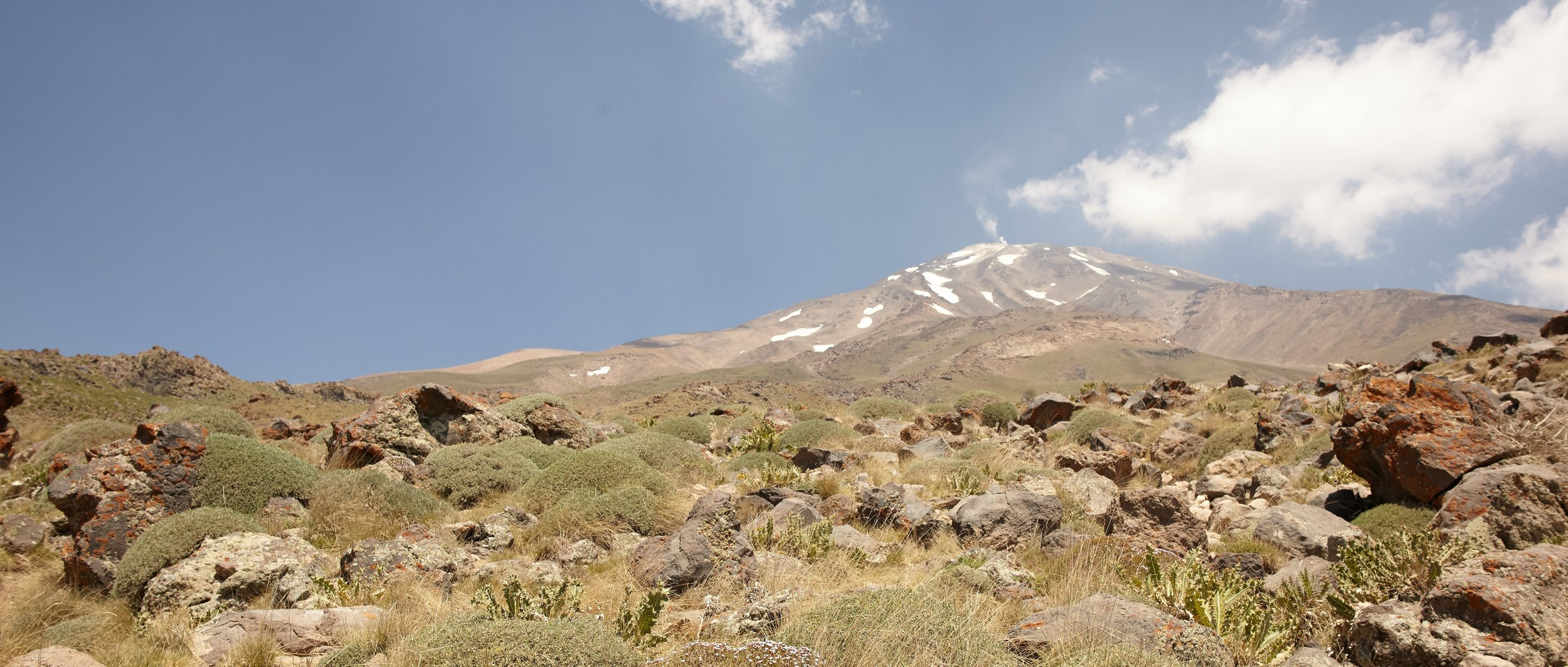 Mt. Damavand as seen from the entrance of the National Park with steam coming from its peak