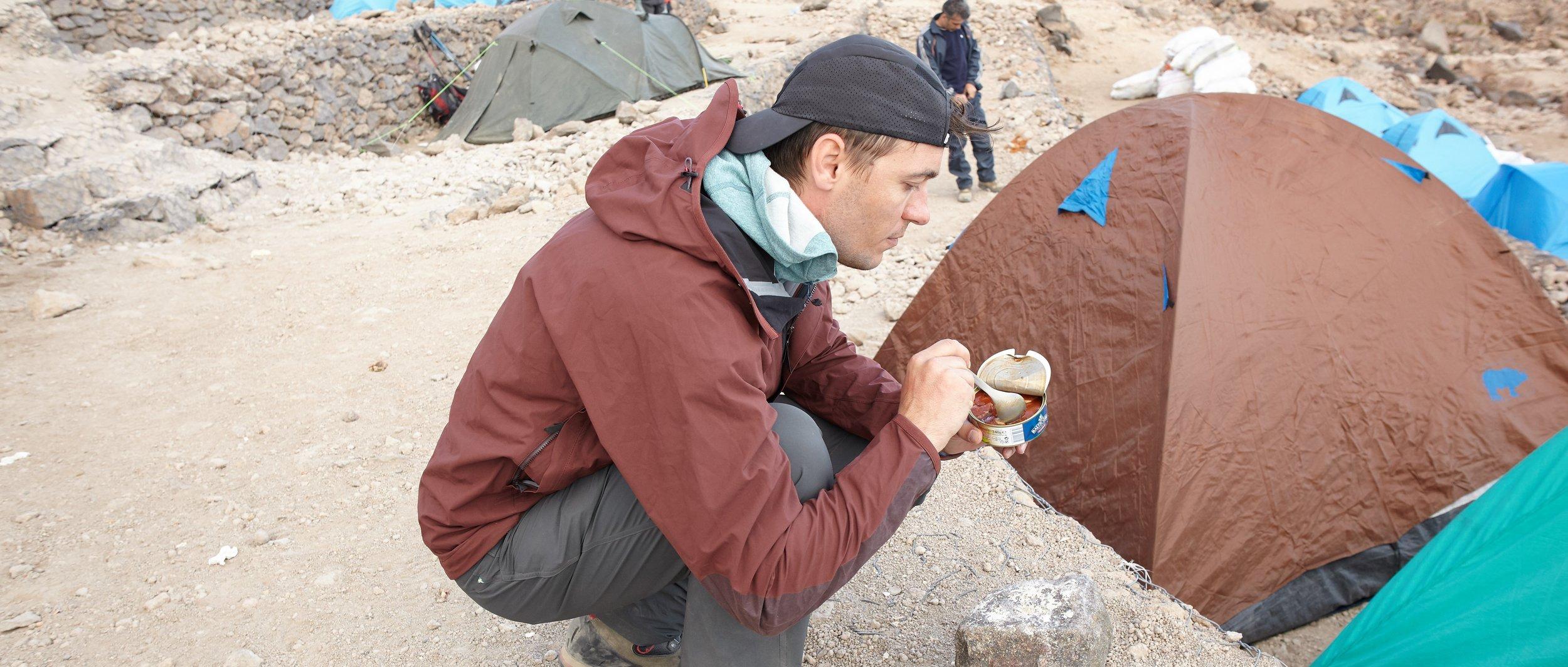 Georgi eats at Base Camp (4200m), Mt. Damavand, Iran