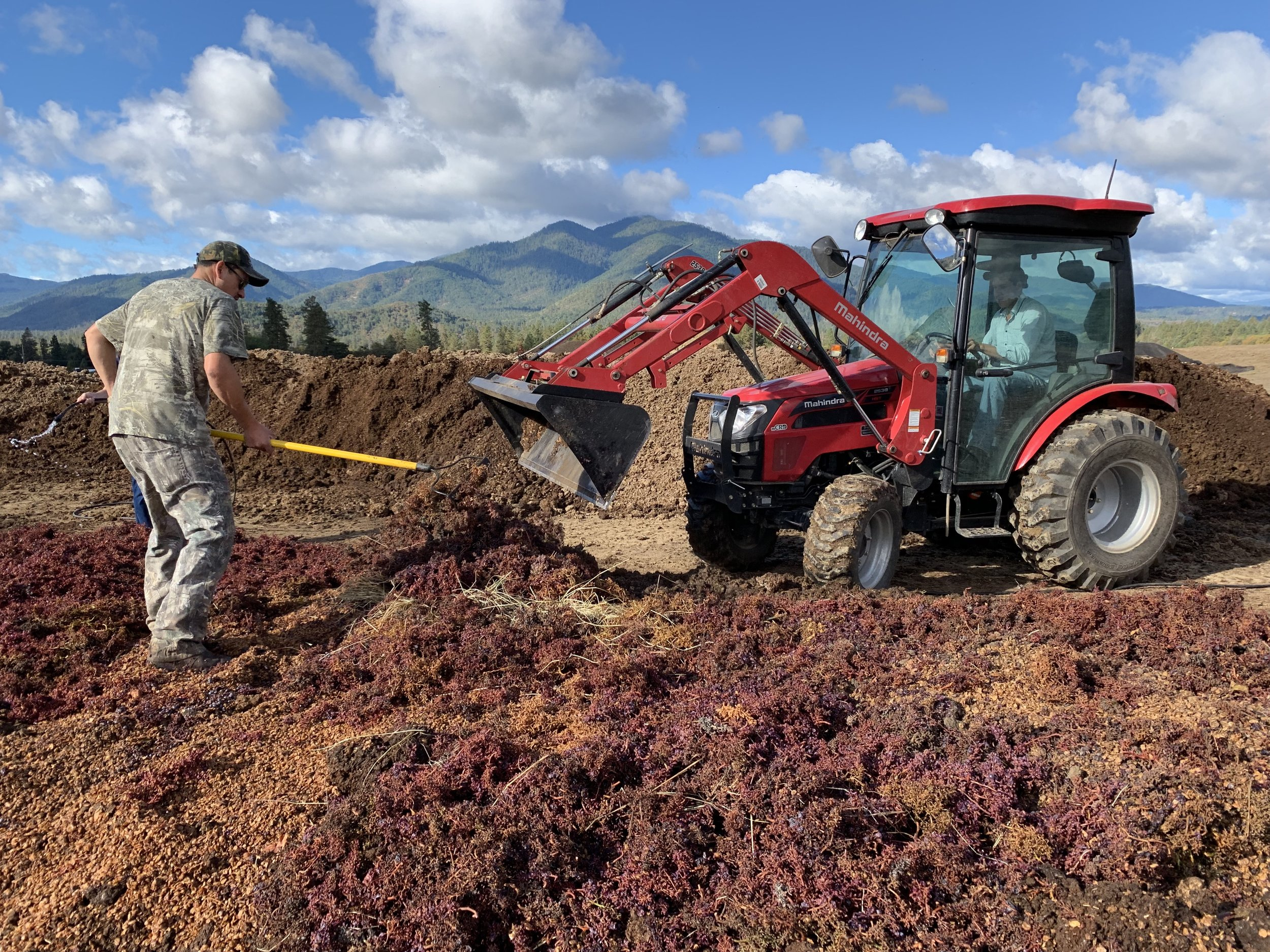 Adding pomace to a new compost pile at Troon Vineyard in Oregon's Applegate Valley.