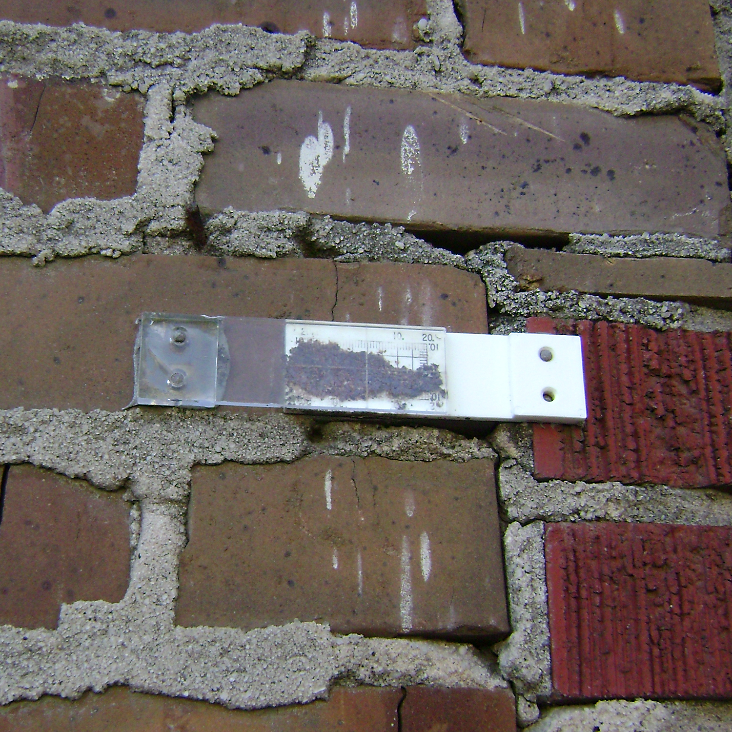 Figure 2. Long-term  crack monitoring  of an old masonry structure. Photo credit: Jason Church, Conservator, National Park Service.