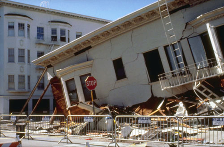 Figure 3. Foundation failure due to soil liquefaction in the San Francisco Marina District during the 1989 Loma Prieta earthquake. Photo Credit: U.S. Geological Survey Department of the Interior/USGS