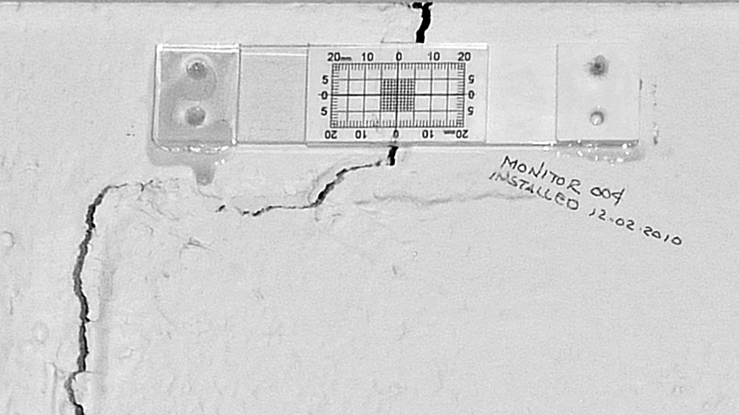 Figure 15. Crack monitor measures wall crack. Photo Credit: Wolfram