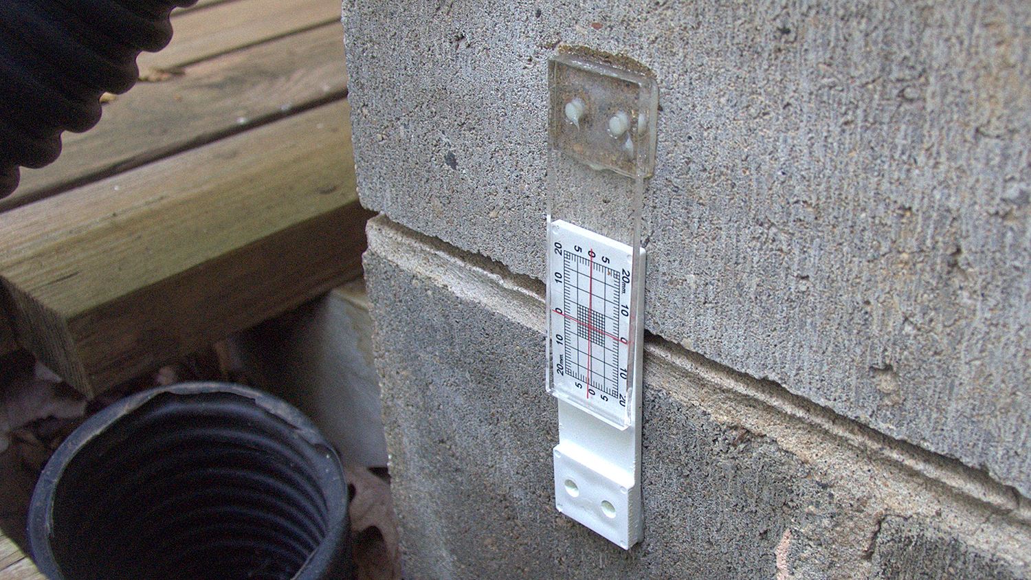 Figure 6. Buildera CrackMON® 2D crack monitor measures vertical separation in block foundation