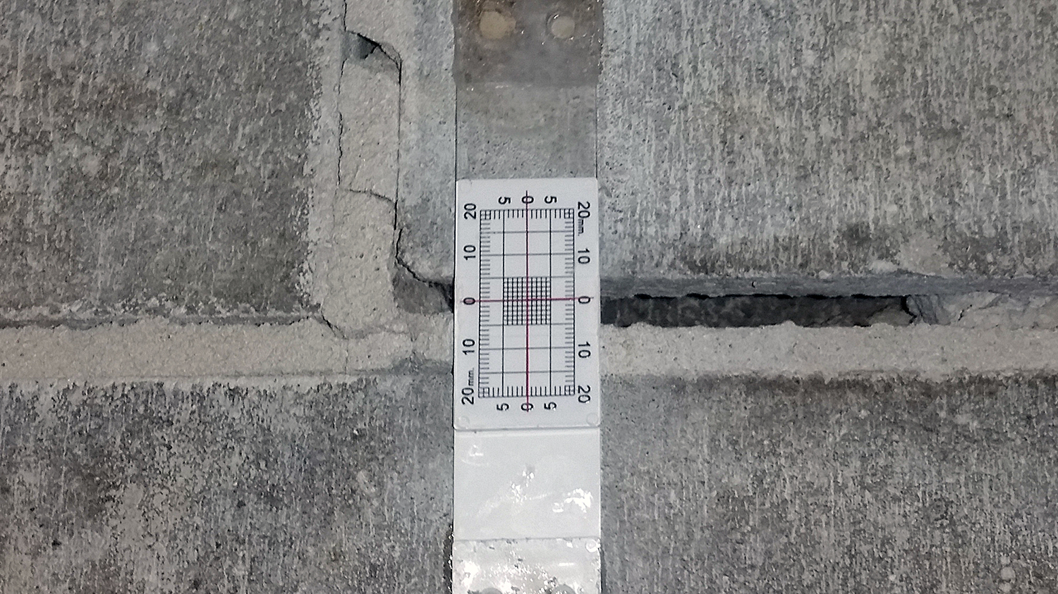 Figure 7. Close-up of Buildera CrackMON® mounted with structural epoxy detects new shifts in crack offsets along x and y axes