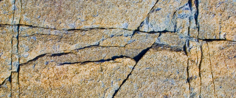 cracked-rock-wall-1500x625.jpg