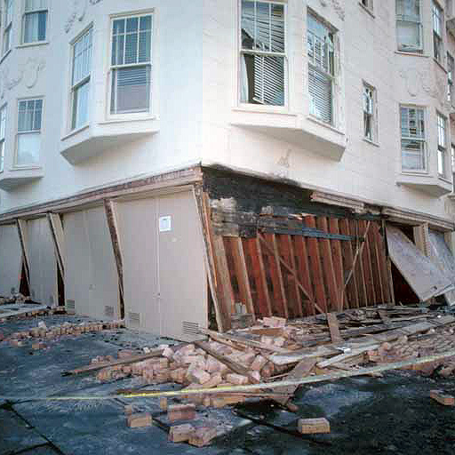 Insufficient shear walls caused catastrophic structural damage to this soft-story San Francisco residential complex during the 1989 Loma Prieta quake. Photo credit: USGS/J.K. Nakata.