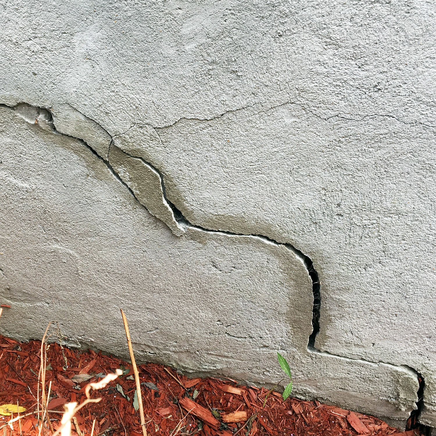 Figure 1. Stepped horizontal and vertical settlement on front-porch foundation.