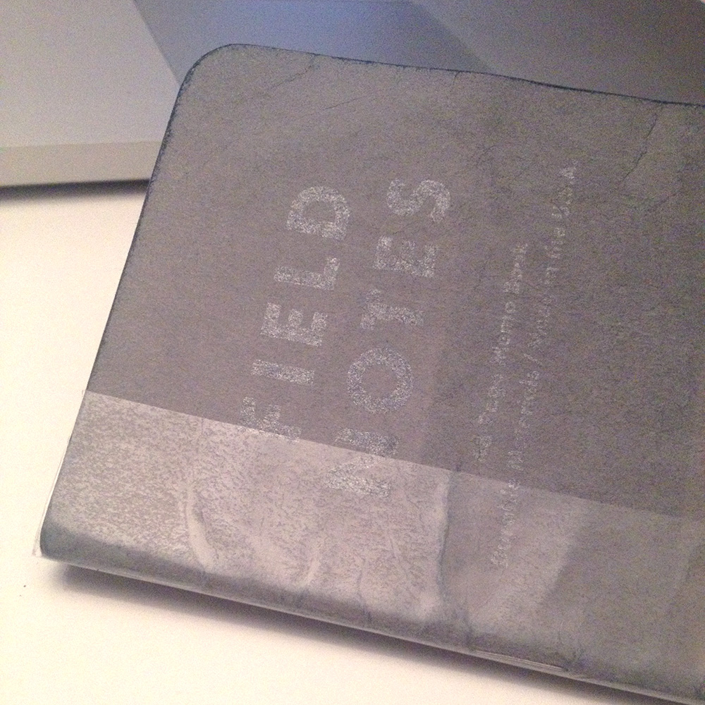 A worn Field Notes book. For those asking: this is the grey & silver book from the J. Crew Edition 3-pack.