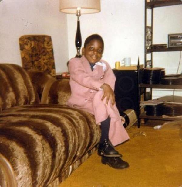 putthison :      Poppa Been Smooth Since Days of Underoos   The Notorious B.I.G. in a pink suit and black bluchers on the day he graduated from kindergarten.