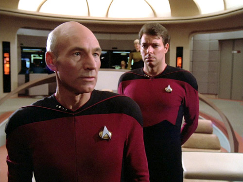 Riker's decision may have been influenced by a love of bald men andEnglish accents. Just look at the admiration going on right here.