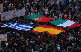 Sciopero 14 novembre 2012 - Folla con bandiere Piigs.jpg