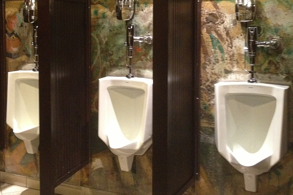 Main street urinals paneled with pieces of the Berlin Wall.