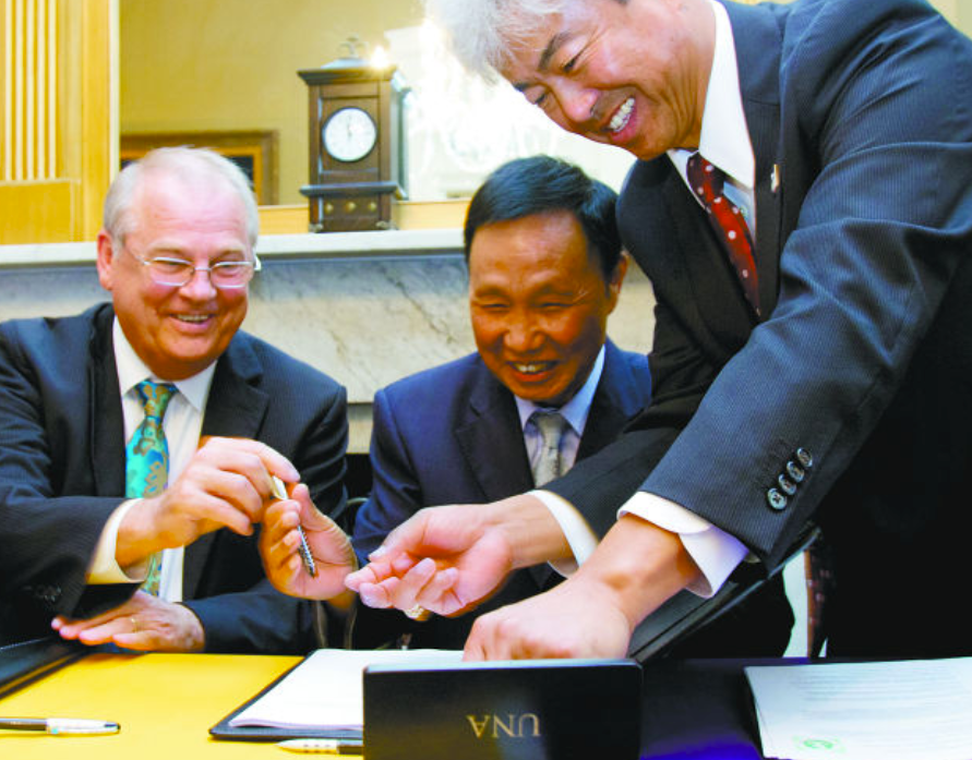 Dr. Zhang's UNA health institute deal (finally) finalizes.