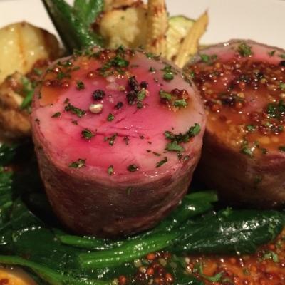 Rolled roast pork with seasonal vegetables