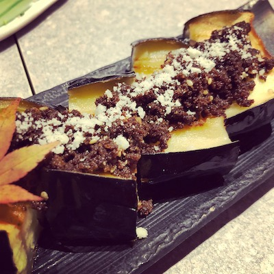 Aubergine topped with miso mince meat