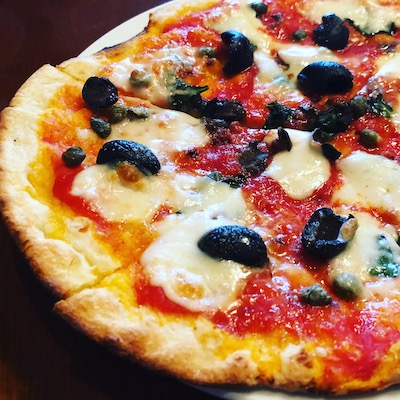 Olive and tomato pizza
