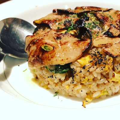 Fried rice topped with foie gras
