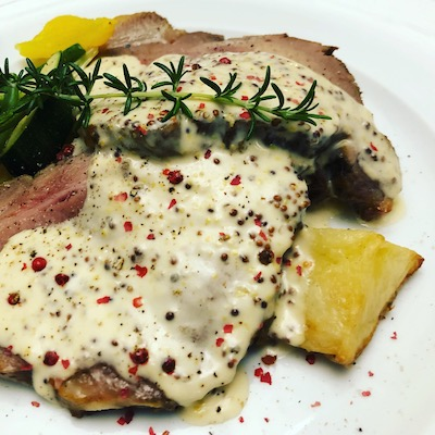 Veal with peppercorn sauce