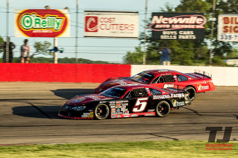 Casey Johnson turns inside John Beale at Jefferson Speedway.