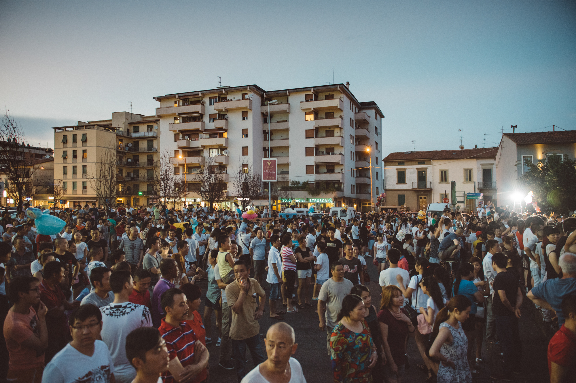 Prato, August 2016. A crowd of Chinese locals in one of the main squares of the local Chinatown, where the Chinese edition of the yearly Watermelon Festival is taking place.