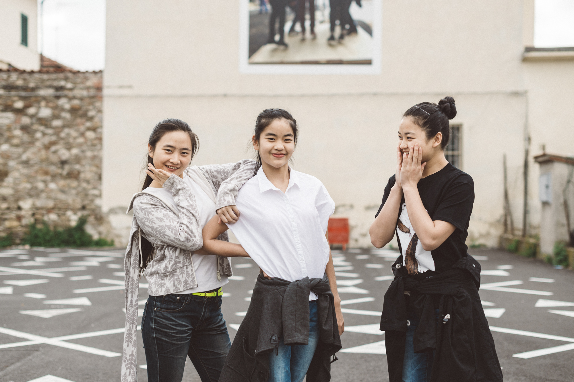 """Prato, April 2016. Three young Chinese performers on the cast of """"The Ghosts"""" by Constanza Macras pose for a portrait in Chinatown. The show talk about the hardships faced by Chinese acrobats, their struggles for fame and glory and their early retirement, condemning them to be soon forgotten."""