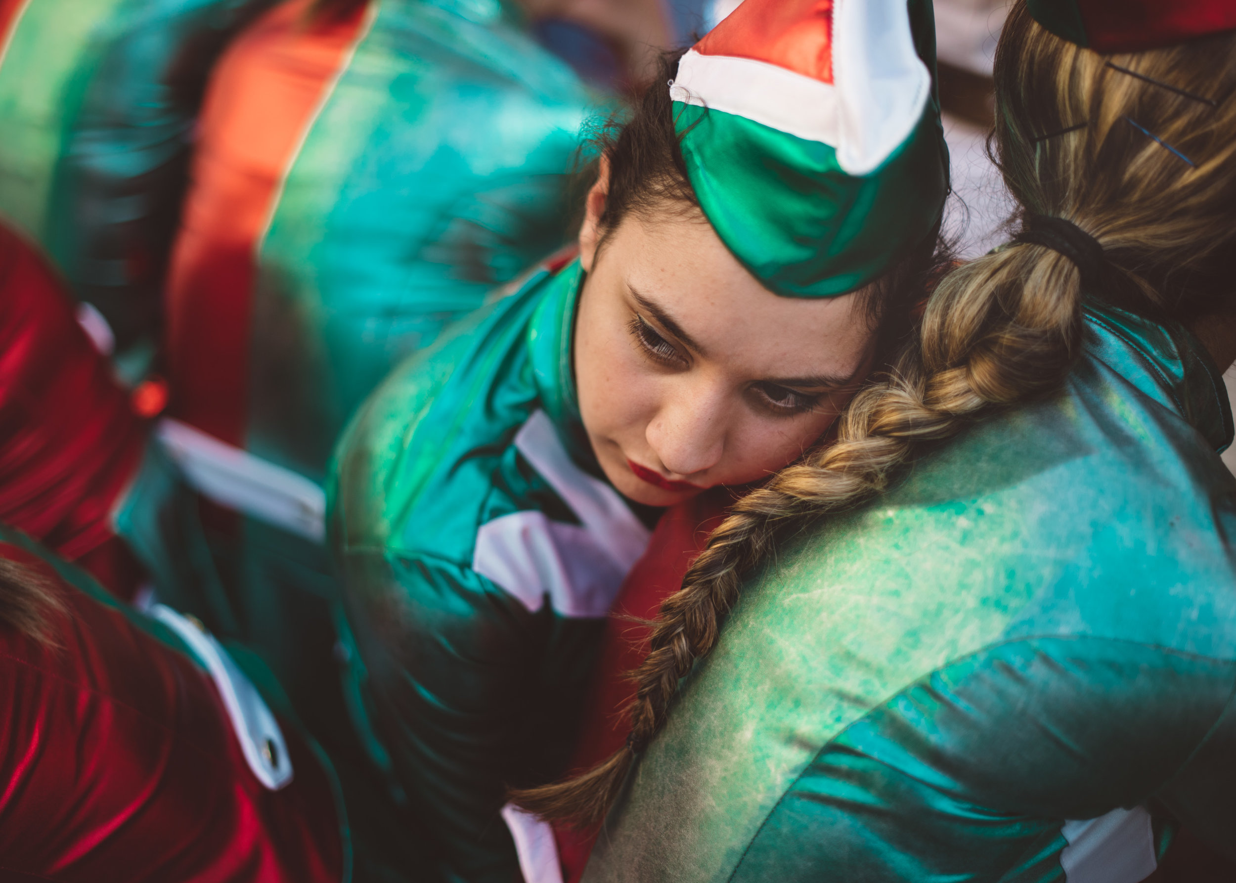 Maria rests her head on her best friend's Teresa back, during a long and exhausting day performing in in small towns around Naples.