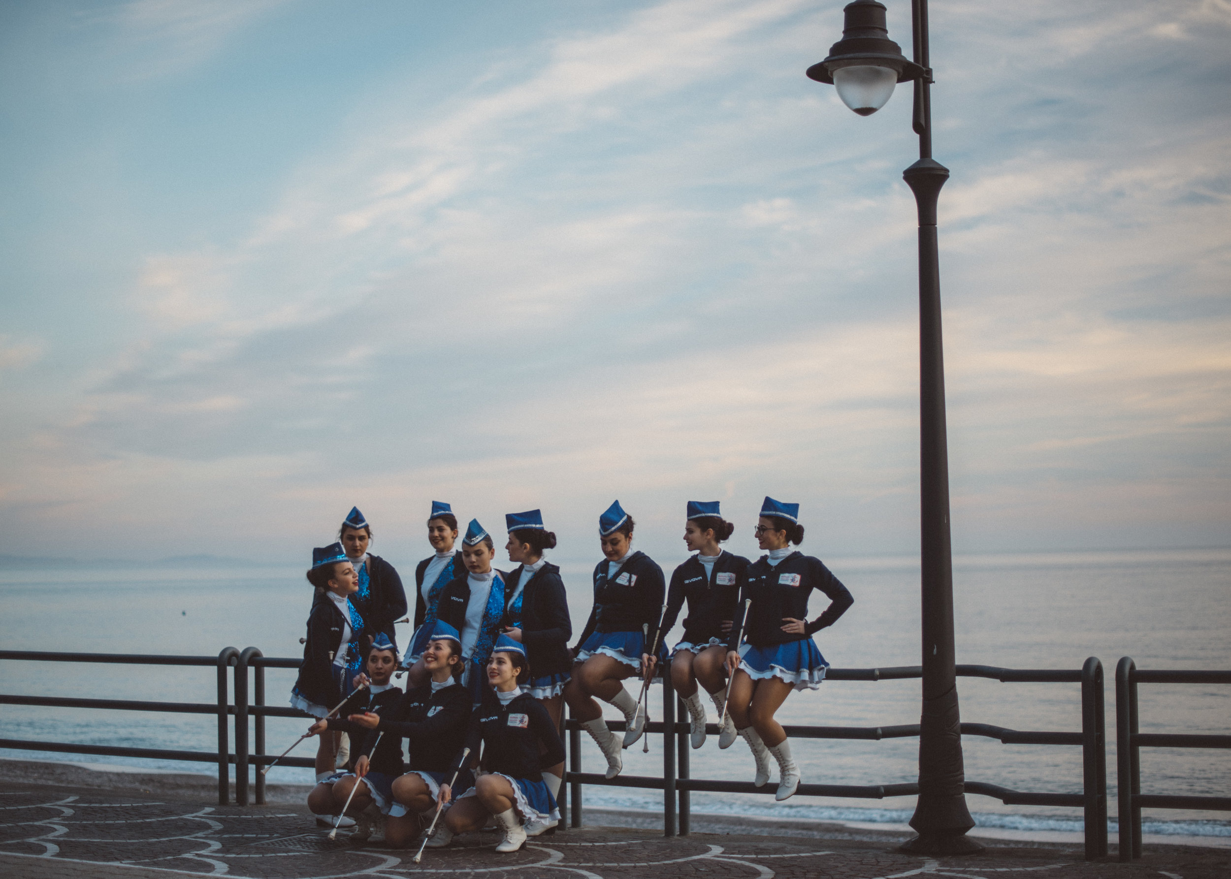 The Sailors Majorette Team posing for a group photograph on the waterfront of Maiori after a majorette and marching band festival.