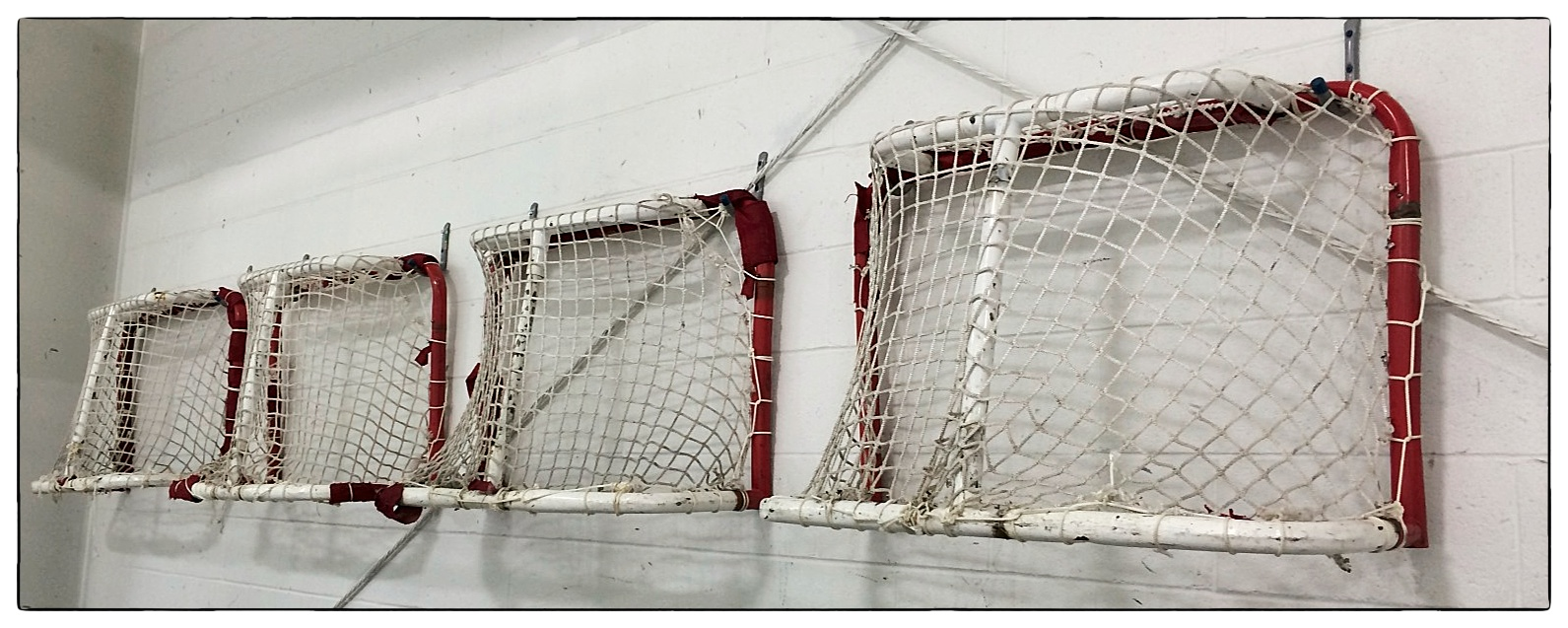 Hockey nets adorning the wall at Norwich Ice Rink, Norwich, Conn., shot on November 13, 2013.