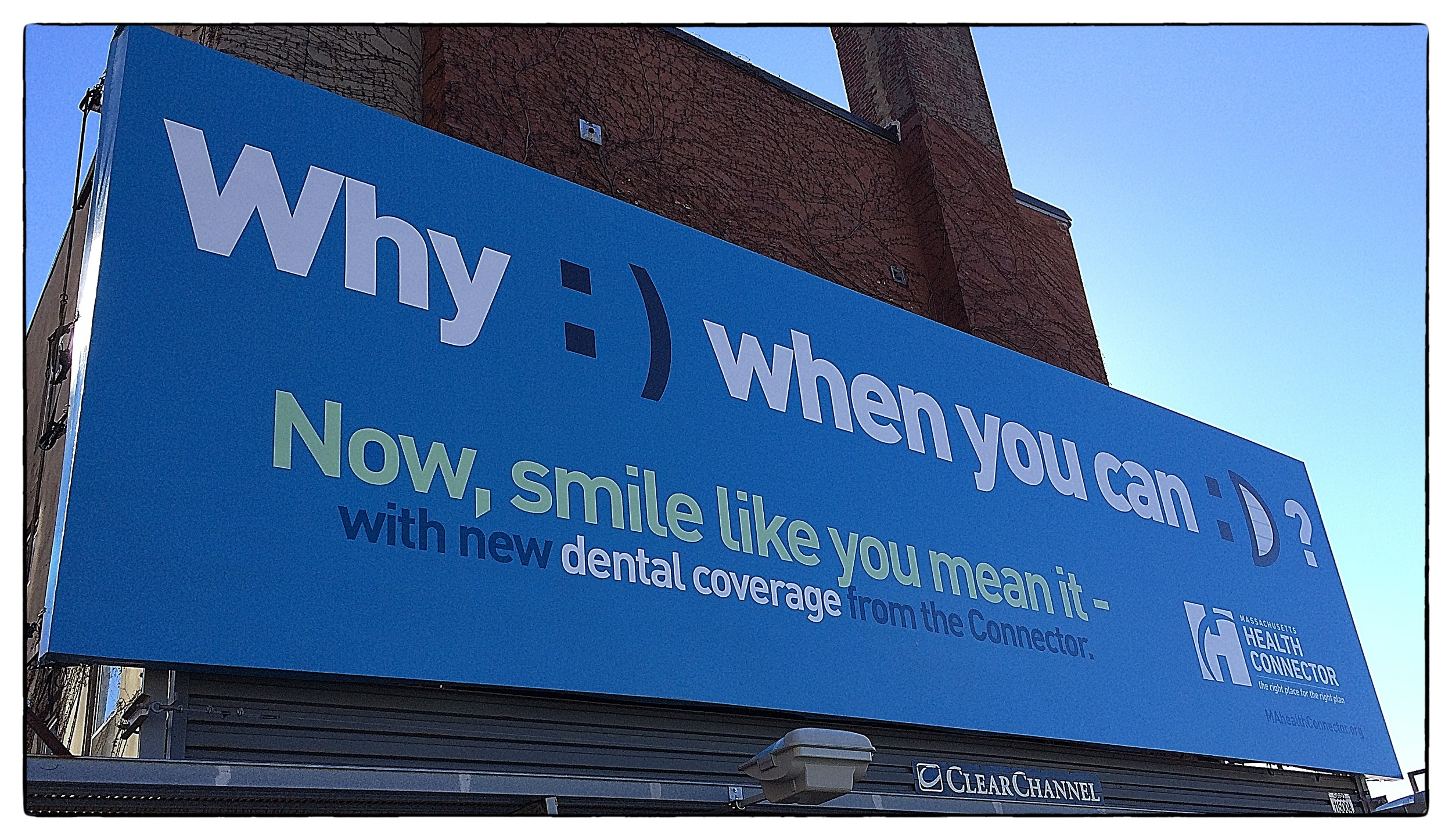 Billboard at the corner of Dorchester Avenue and West 4th Street in South Boston, shot on November 19, 2013.