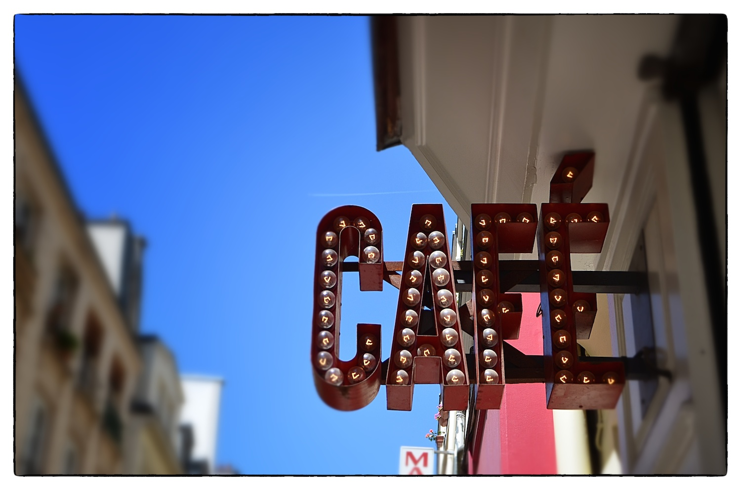 The sign outside  Café Loustic  in the Marais district of Paris, shot on June 21, 2014.