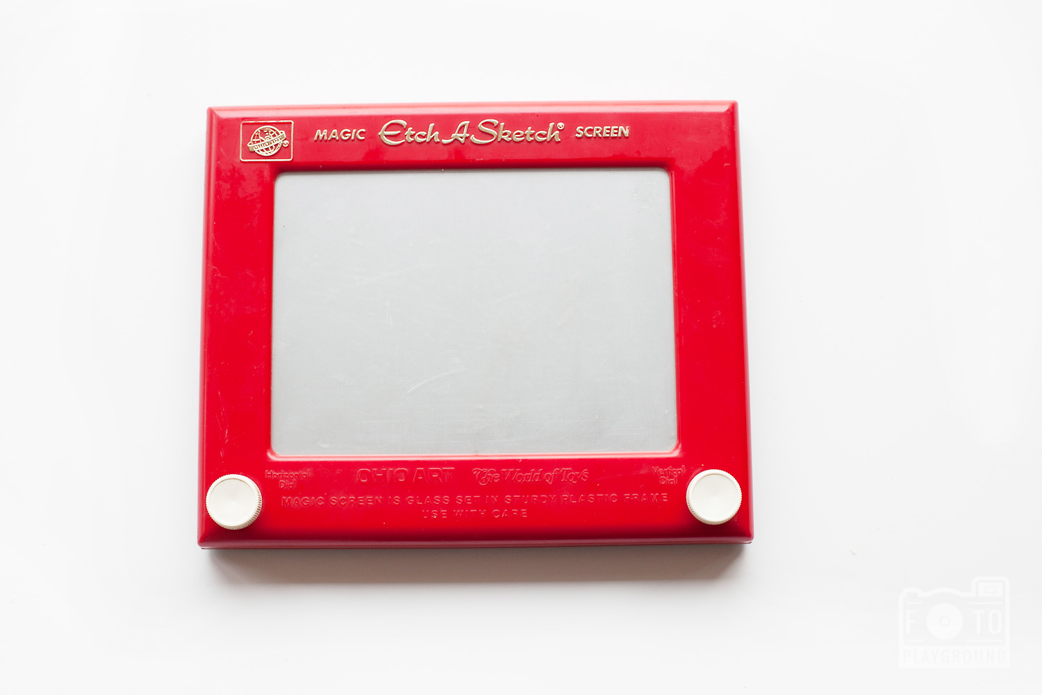 etch-a-sketch + a sharpie for your own message