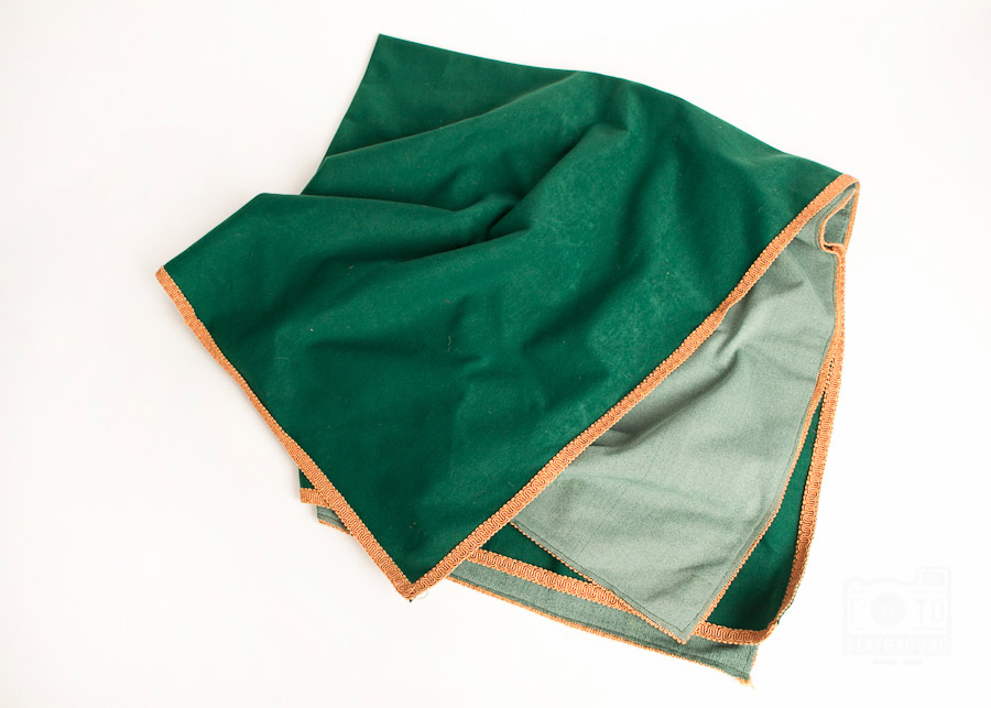 green fabric with gold trim