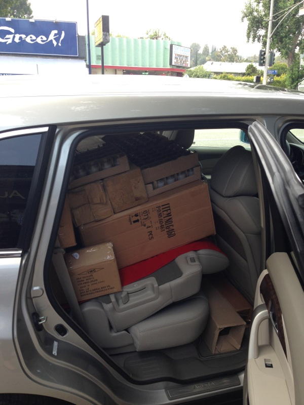 One car loaded up with over seven dozen vases and over one hundred candles that will transform the room for the reception.