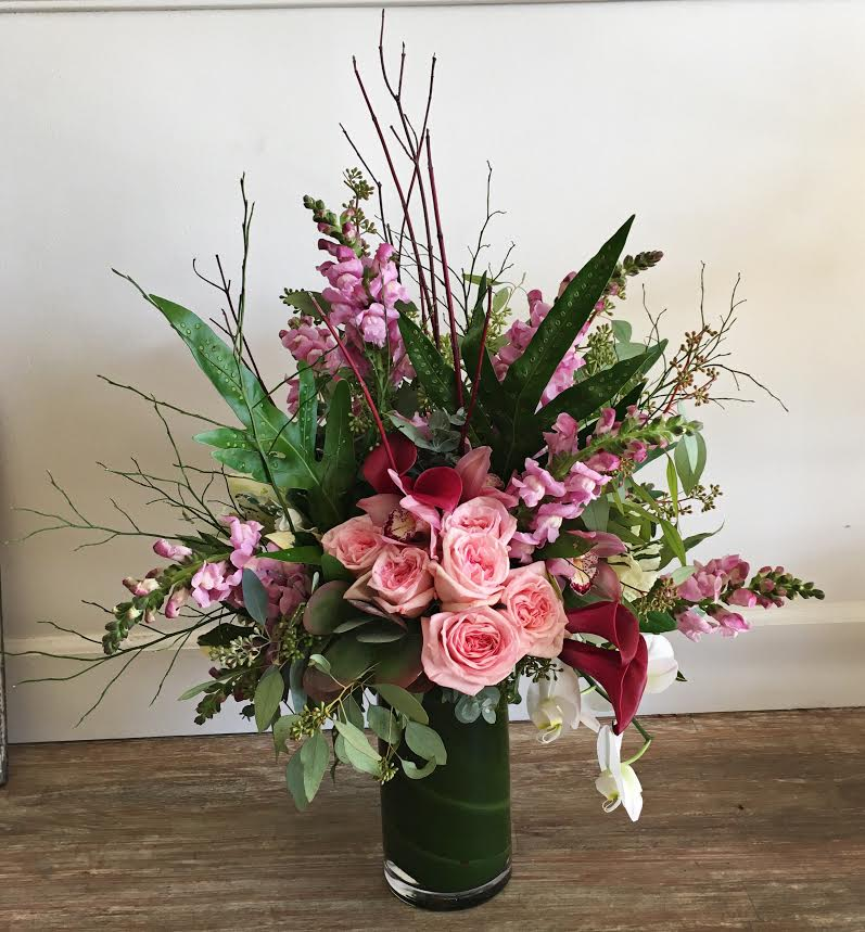 $250 arrangement in a tall, glass vase (leaf-lined)