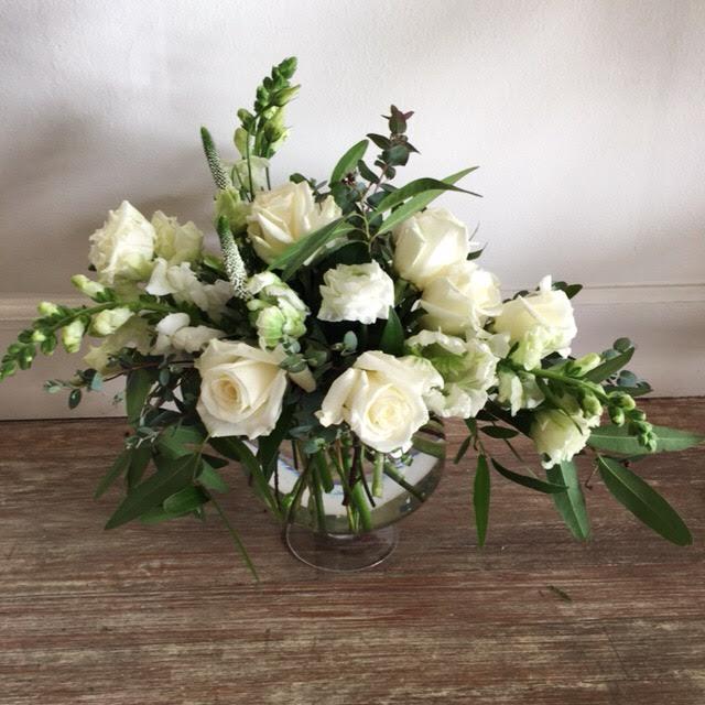 $70 arrangement in a glass pedestal vase