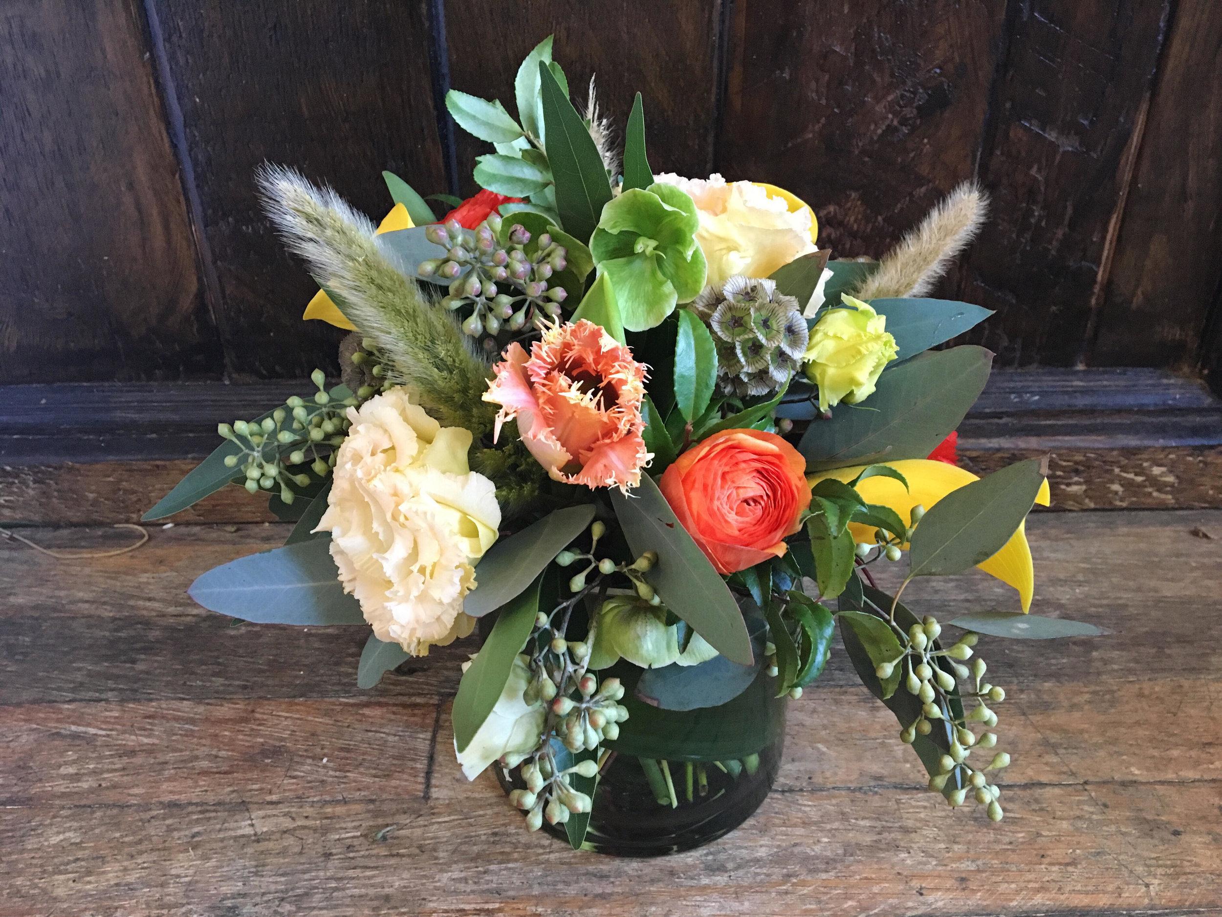 $50 arrangement in a glass vase (leaf-lined)
