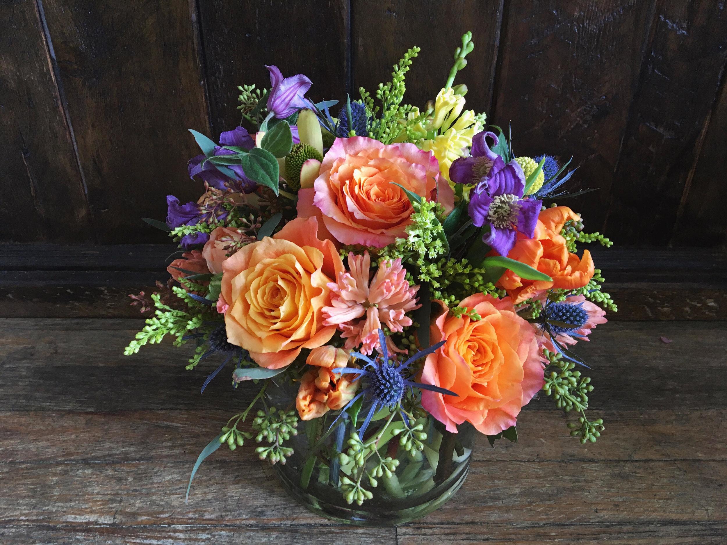 $100 arrangement in a glass vase