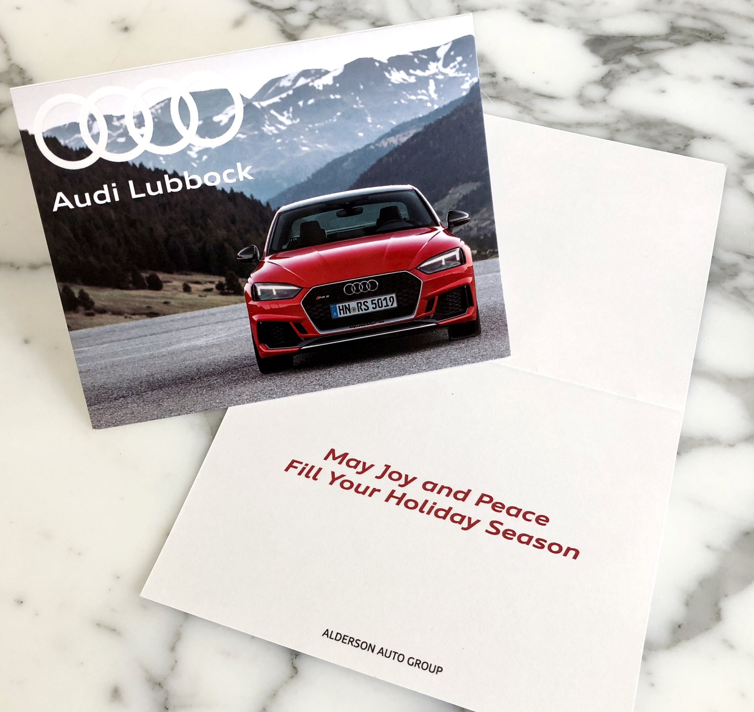 Audi Christmas Card - Multi-gloss coating to highlight the vehicle on the front of the card.