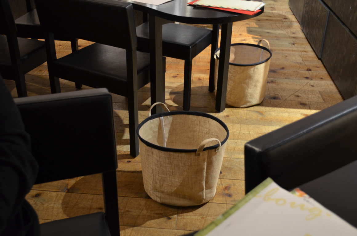 Restaurants have baskets available for you to place your bag in so it doesn't have to get dirty on the floor. Photo credit to kimberlyah.com