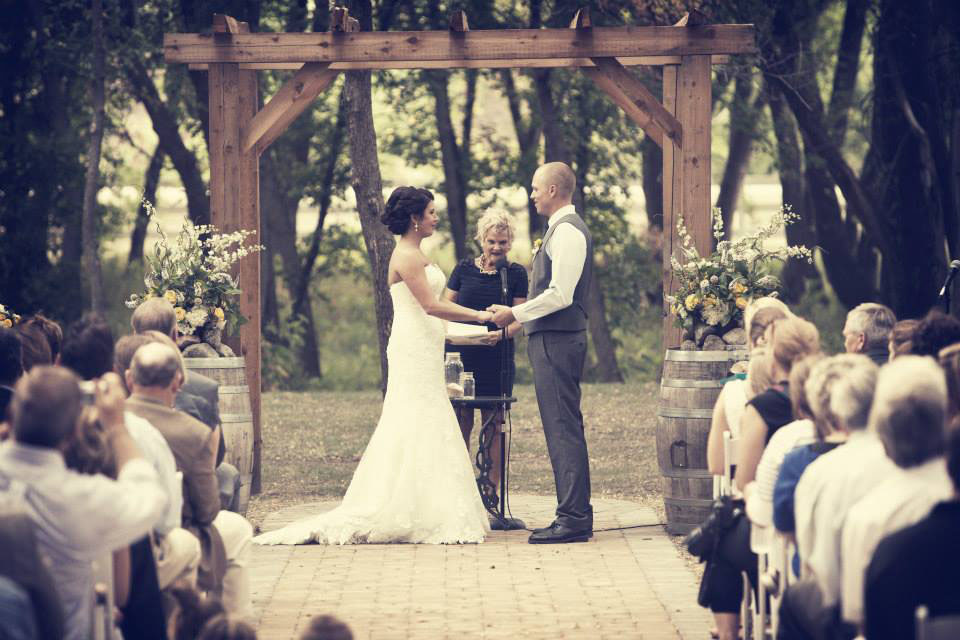 Wedding vows in the Natural Cathedral at Carlos Creek Winery.