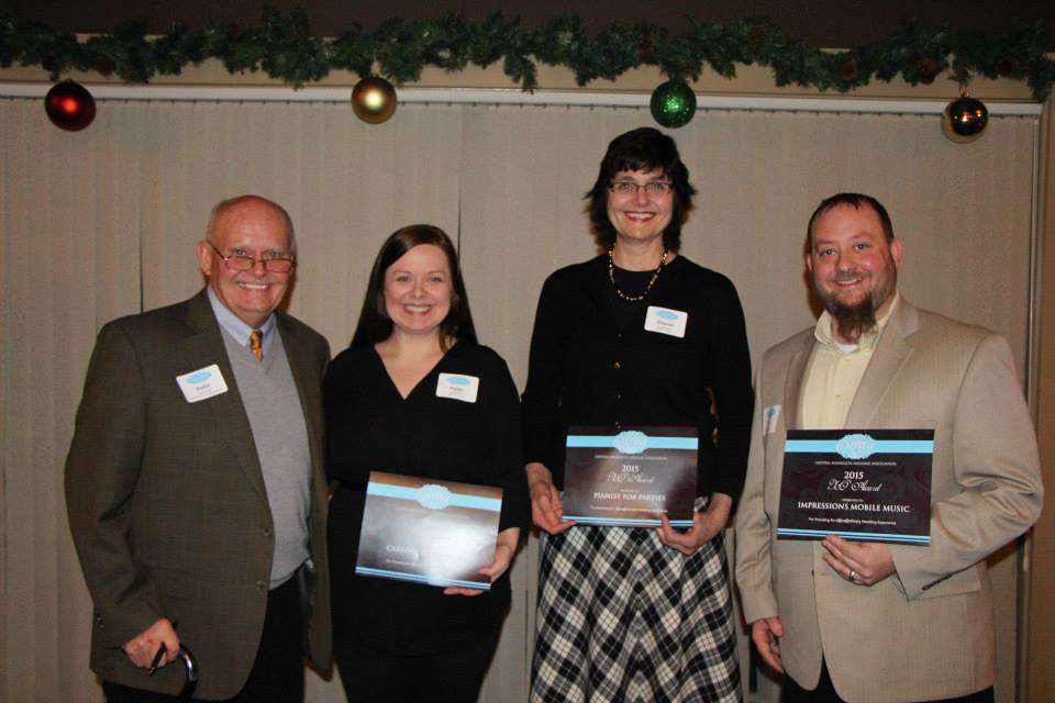 CMWA President, Rollie Carlson, presented the 'Xo' awards to Paige Meier, Sharon Planer & Larry Rowe.