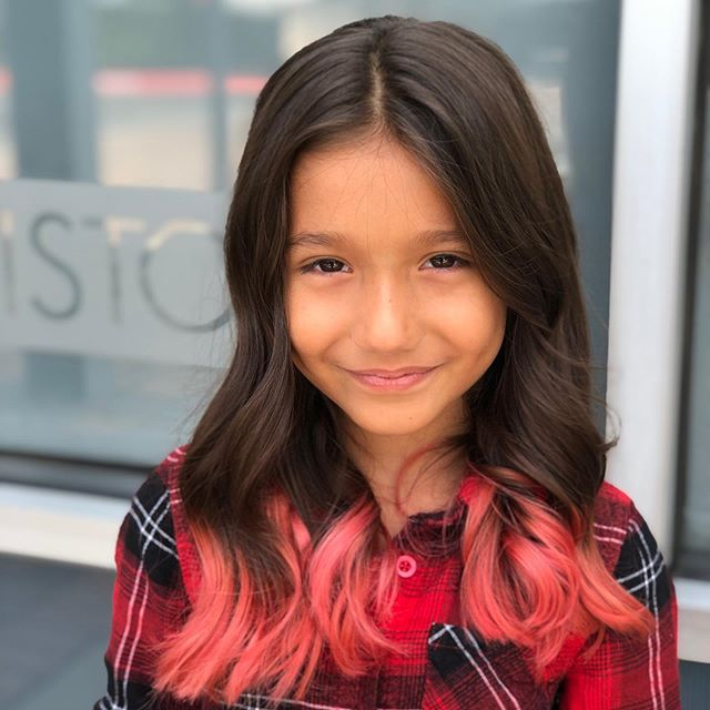 "A little behind on this #repost by @arianbrumby but we couldn't not post! ""Gave this little cutie her very first hair color today! She was so happy at the end when she saw her new bright pink hair!  She definitely made my day. 💗 😊"" ⠀⠀ #pinkhair #austin #atxhair #pinkombre #austincolorist #austinsalon #austinhair #austinhairstylist #atxstylist #pink #fashioncolors #goldwellcolor #goldwellus"