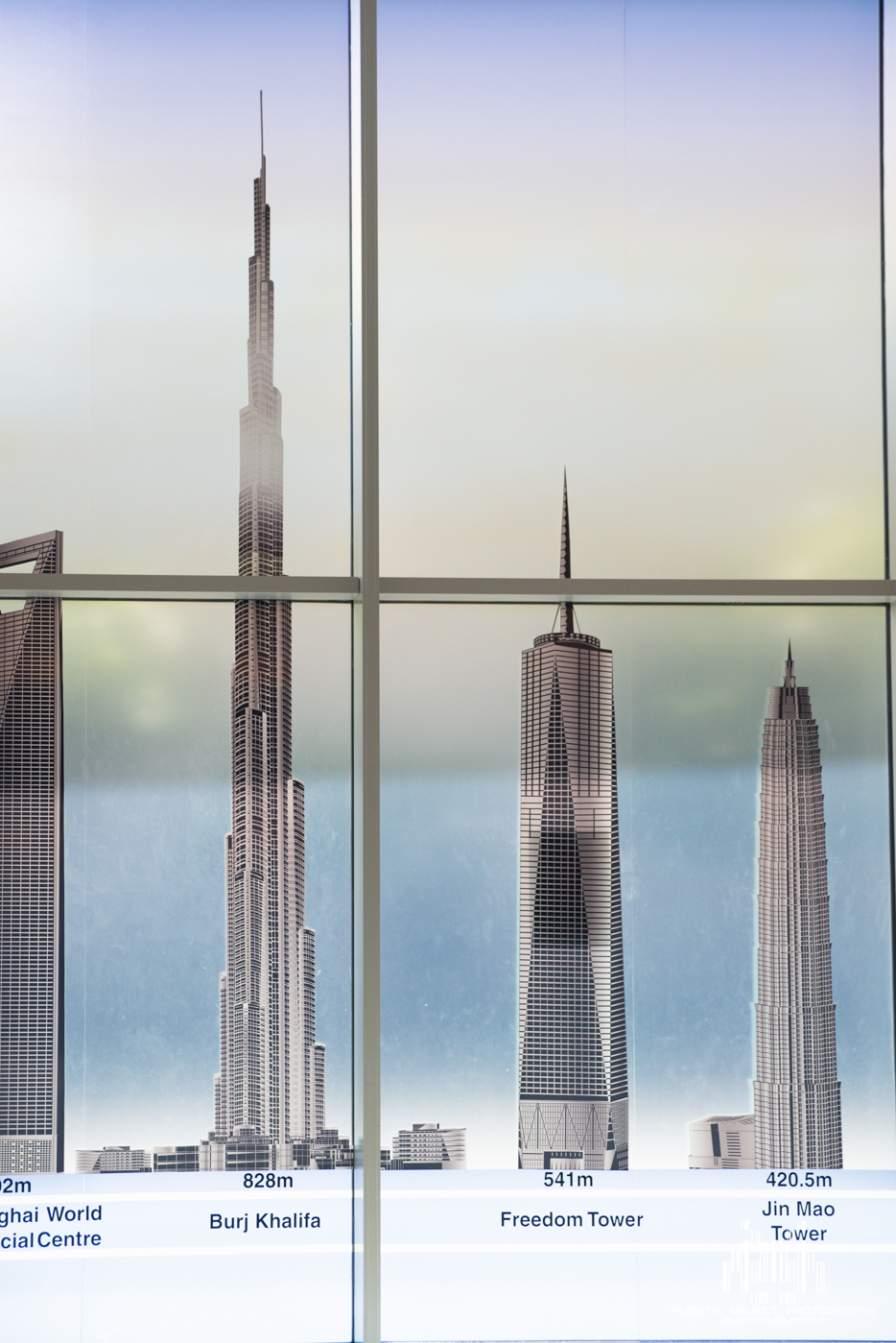 I did find this interesting. The Freedom tower isn't even complete yet and there it is directly beside the Burj Khalifa. This mural was completed almost 3 years ago.