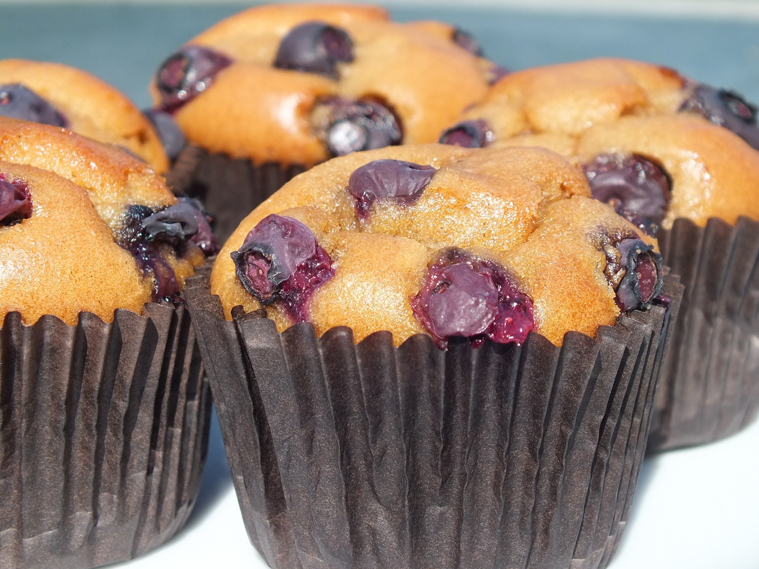 Blueberry topped almond paste muffins