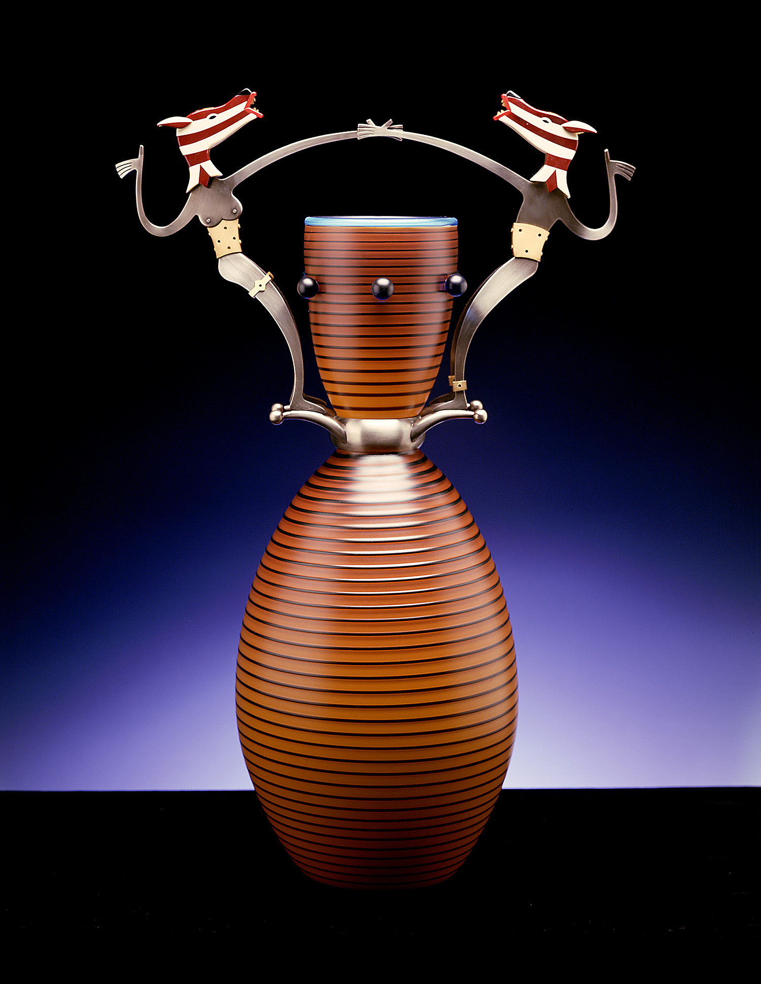 Marvelous Spectacle   2003. Blown glass, nickel and gold-plated bronze, Vitrolite. 27½ x 16½ x 10""
