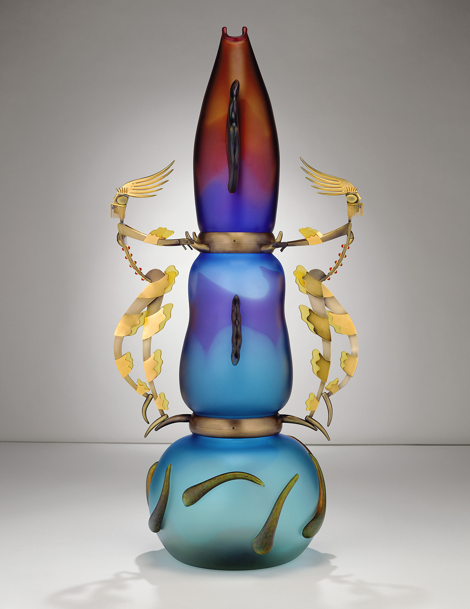 Masked Seducers   1999. Blown glass, bronze and gold-plated bronze, pate de verre. 58½ x 28 x 21""