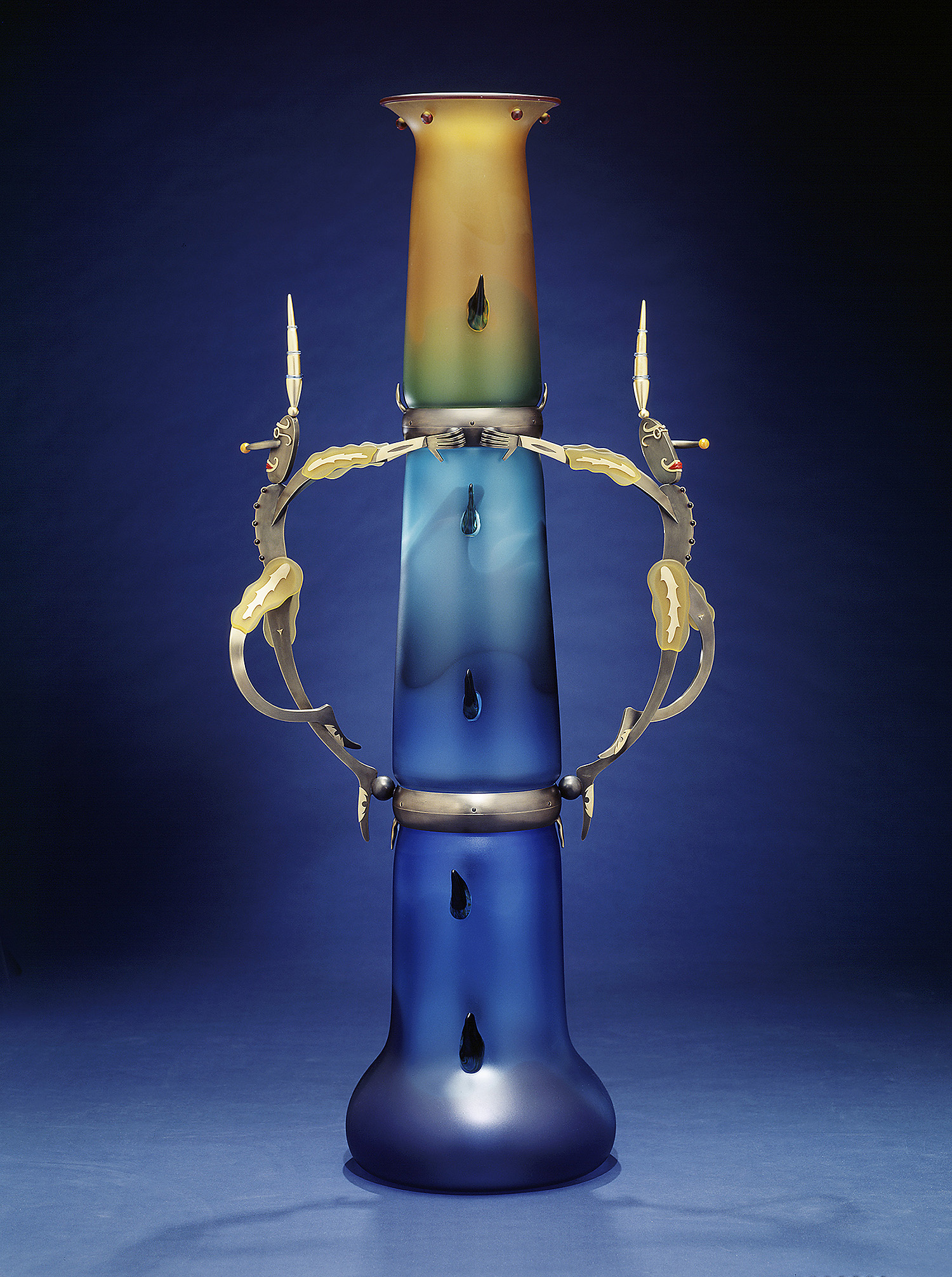 Prancing Fools   1999. Blown glass, aluminum and gold-plated bronze, Vitrolite. 63½ x 32 x 16½""