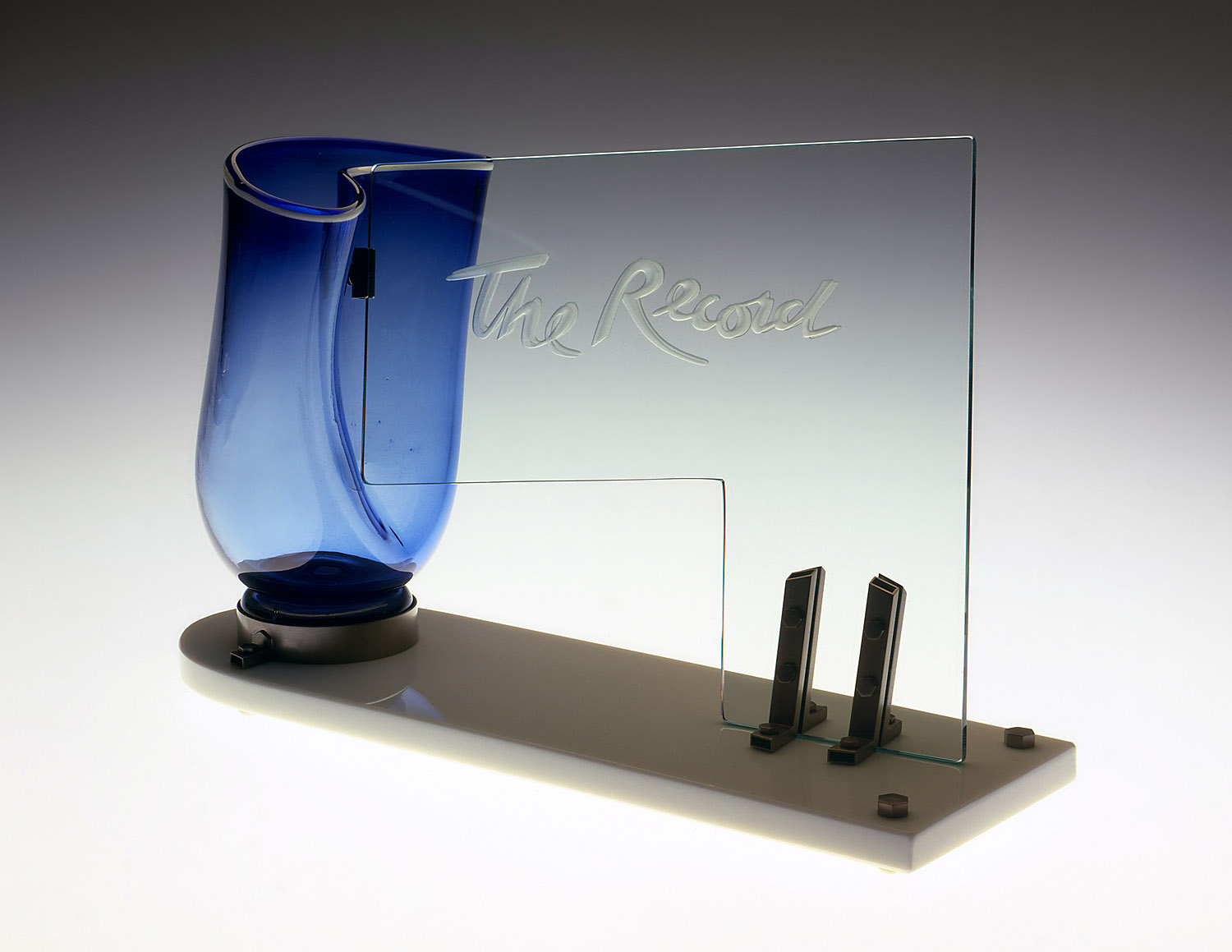 The Record   1980. Blown glass, plate glass, nickel plated brass. 15 x 19 x 7""